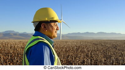 Male engineer standing in the wind farm 4k - Male engineer...