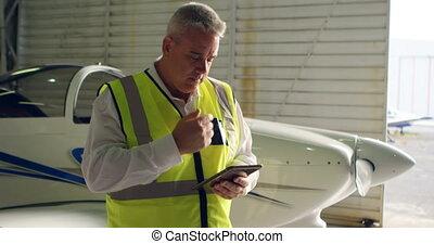 Male engineer using digital tablet 4k - Male engineer using ...