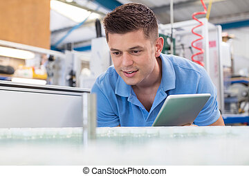 Male Engineer With Digital Tablet Working In Bottle Capping...