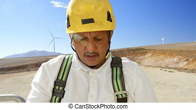 Male engineer working in the wind farm 4k - Male engineer...