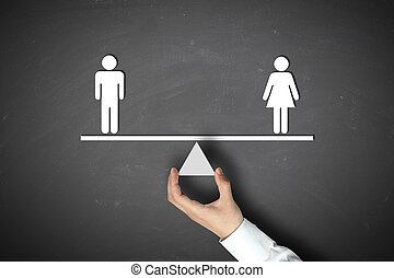 Male equals female concept with businessman hand holding ...