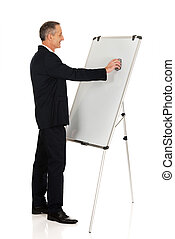 Male executive cleaning a flip chart