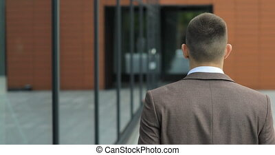 Male executive feeling career success satisfaction. Rear view of man