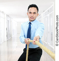 man pulling a rope