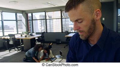 Male executive using mobile phone 4k - Male executive using ...