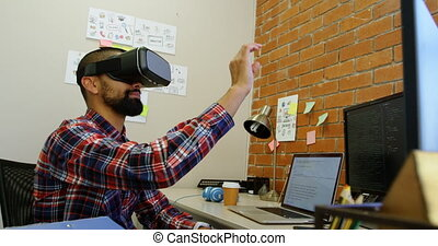 Male executive using virtual reality headset in office 4k