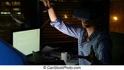 Male executive using virtual reality headset at desk 4k