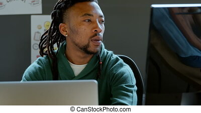 Male executive working at desk in office 4k
