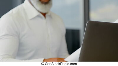 Male executive working at desk in the office 4k