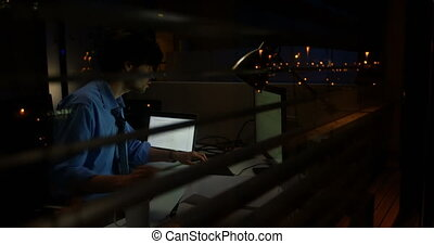 Male executive working on computer at desk 4k