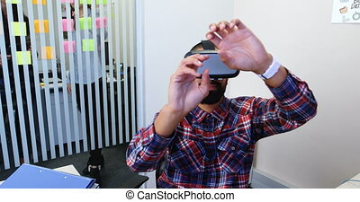 Male executives using virtual reality headset in office 4k