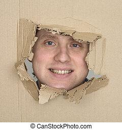 Male face in hole carton
