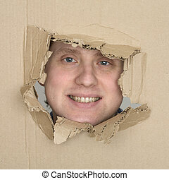 Male face in hole carton