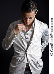 Male fashion - Fashionable young man arranging his elegant ...