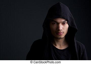 Male fashion model on black background