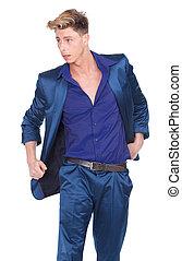 Male fashion model posing in blue suit