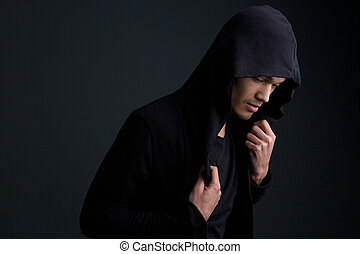 Male fashion model posing on gray background