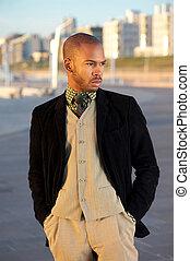 Male fashion model posing outdoors
