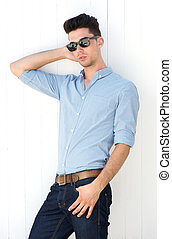 Male fashion model posing with sunglasses