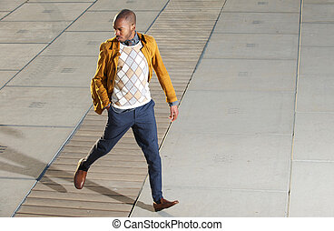 Male fashion model walkig outdoors