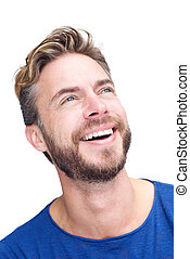 Male fashion model with beard laughing