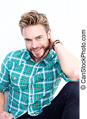 Male fashion model with beard smiling