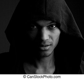 Male fashion model with serious expression on face