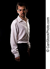 Male fashion - Handsome brunette young man wearing white...