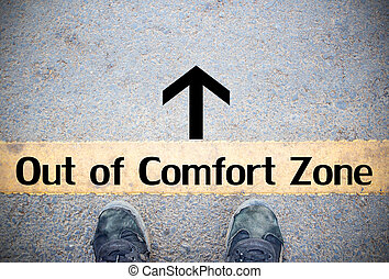 Male feet and old black shoes standing on the concrete floor or street asphalt pavement with dividing line. Space for text and design and Comfort Zone Concept