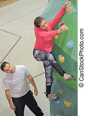 male female indoor rock climbing