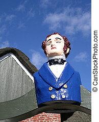 Male figurehead on cloudy sky. Shot in denmark.