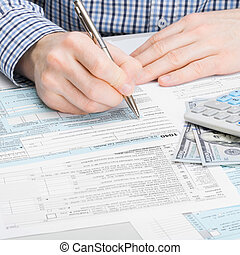 Male filling out 1040 USA Tax Form