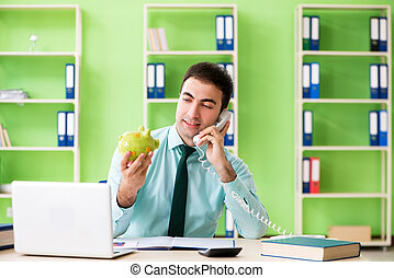 Male financial manager working in the office