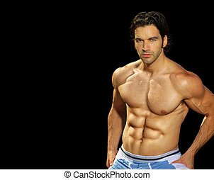 Male fitness model on black background - Sexy male fitness...