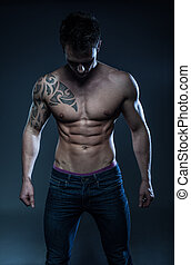 male fitness model with the tattoo