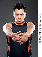 male fitness sports model - young sport fitness man making...
