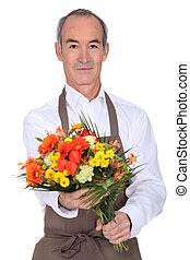 Male florist with a bunch of flowers