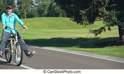 Male fool around on bike. - Man happily cycling. Guy riding...