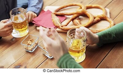 male friends drinking beer at bar or pub