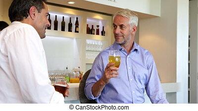 Male friends enjoying a beer togeth