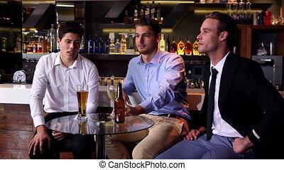 Male friends enjoying a beer