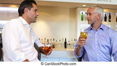 Male friends having a beer together