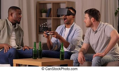 male friends playing video games at home at night - ...