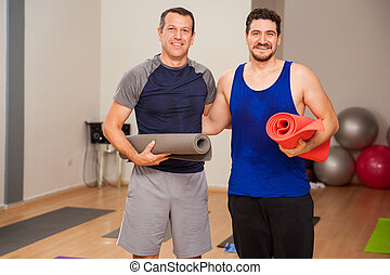 Male friends ready for yoga class