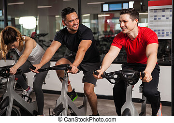 Male friends working out together in a gym