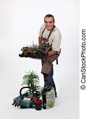 Male gardener in studio