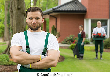 Male gardener in the close-up - Brown haired male gardener...