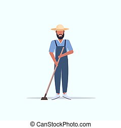 male gardener using hoe countryman hoeing in garden planting harvesting gardening eco farming concept full length