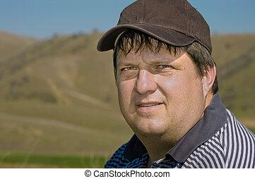 Male golfer close up