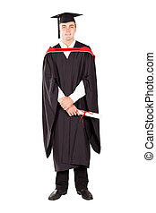 male graduate in cap and gown full length